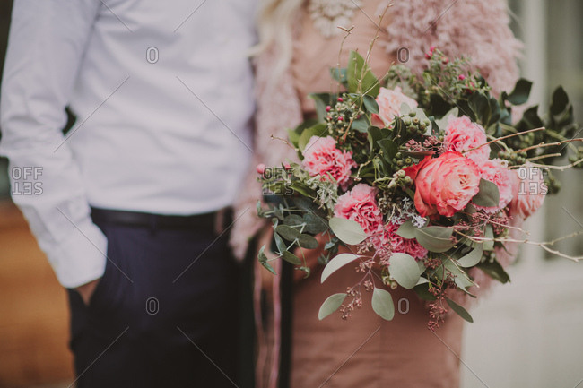 Bridal couple with flower bouquet