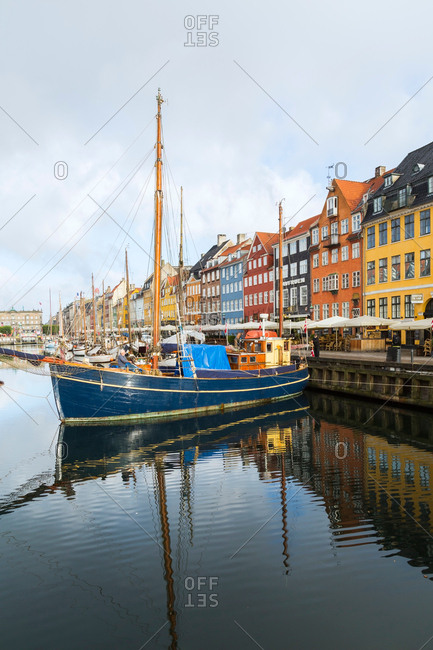September 10, 2017: Moored sailboats and colorful 17th century town houses on Nyhavn canal, Copenhagen, Denmark