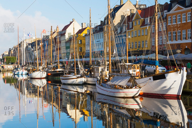 September 10, 2017: Moored boats and colorful 17th century town houses on Nyhavn canal, Copenhagen, Denmark