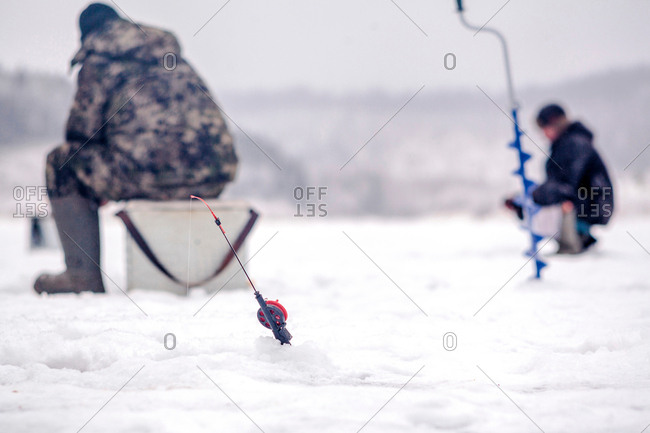 Men ice-fishing, Ural, Sverdlovsk, Russia