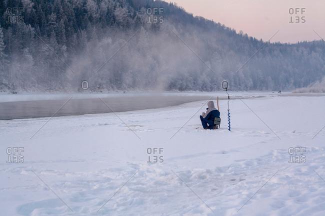 Man ice-fishing, Ural, Sverdlovsk, Russia