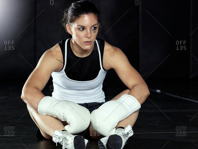 Boxer taking break in gym
