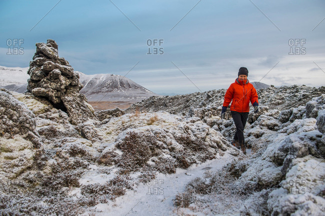 Hiker hiking on Bersekerhraun, Snaefellsnes Peninsula, Iceland, Europe