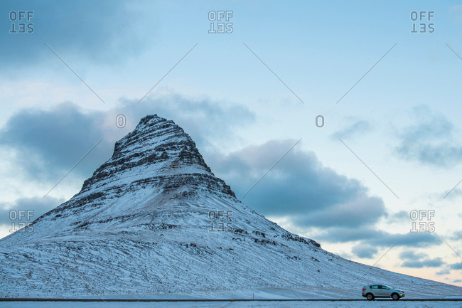 Car by Kirkjufell mountain, Snaefellsnes peninsula, Iceland, Europe