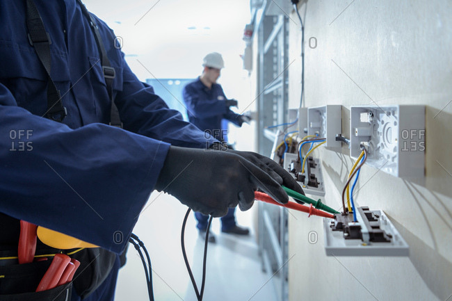 Electrical engineers testing electrical equipment