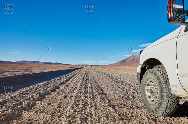 Campervan parked on desert dirt track, San Pedro de Atacama, Chile