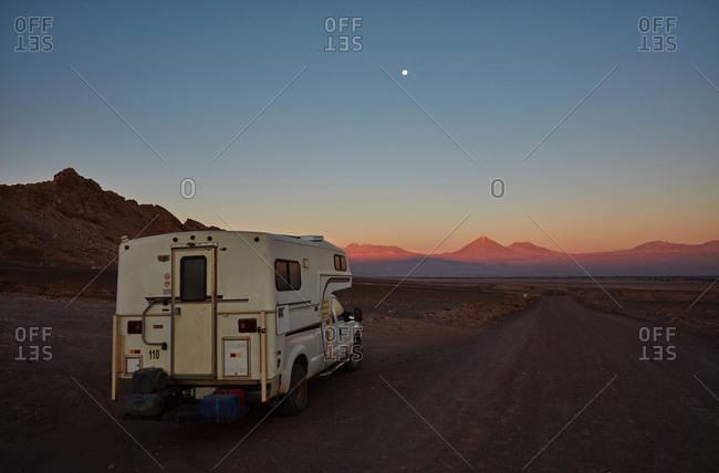Campervan in Valle de la Luna at sunset, San Pedro, Atacama, Chile
