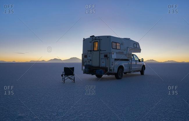 Recreational vehicle parked on salt flats, Salar de Uyuni, Uyuni, Oruro, Bolivia, South America