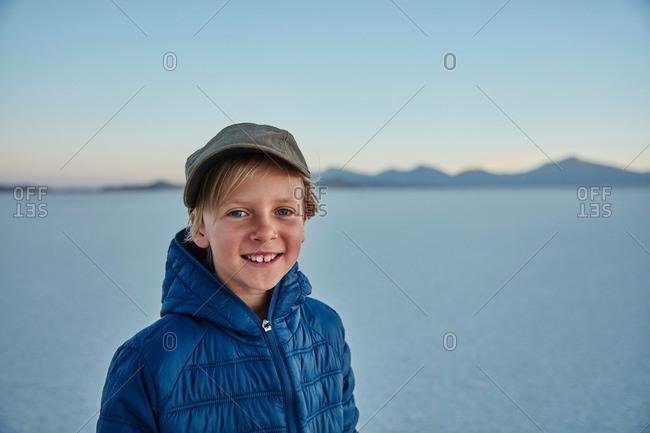 Portrait of boy on salt flats, Salar de Uyuni, Uyuni, Oruro, Bolivia, South America