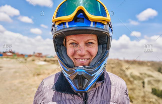 Portrait of woman wearing crash helmet, close-up, La Paz, Bolivia, South America