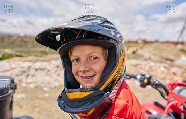 Portrait of boy wearing crash helmet, close-up, La Paz, Bolivia, South America
