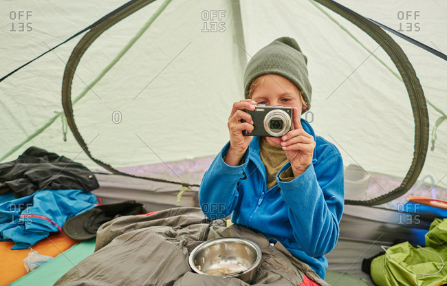 Boy sitting in tent, looking at camera, Ventilla, La Paz, Bolivia, South America