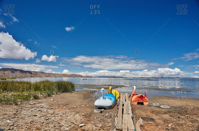 Swan pedal boats on beach, Huarina, La Paz, Bolivia, South America
