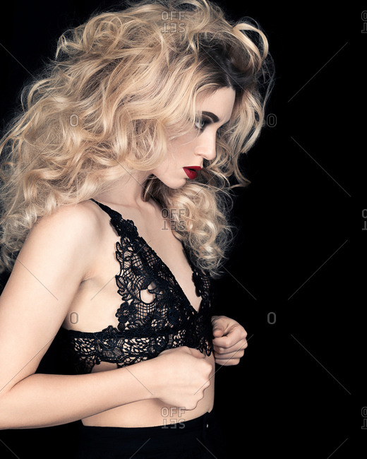 Studio portrait of glamorous young woman in lace brassiere