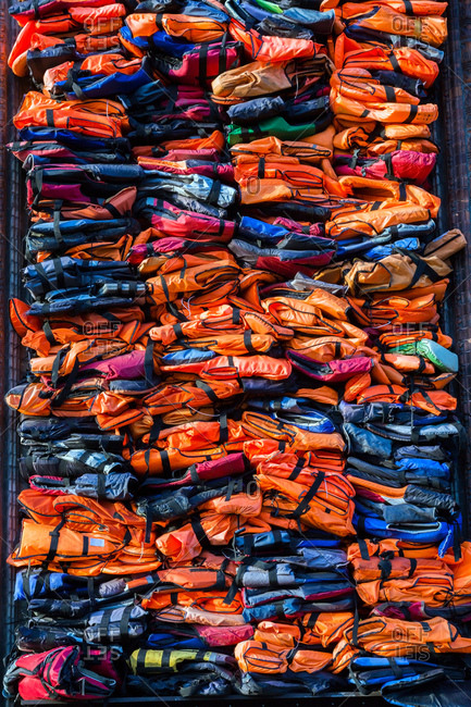 Colorful stacked migrant lifejackets exhibition - Soleil Levant by Chinese artist Ai Weiwei, Nyhavn, Copenhagen, Denmark