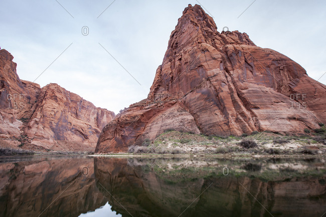 Idyllic view of river by rocky mountains against sky at Marble Canyon