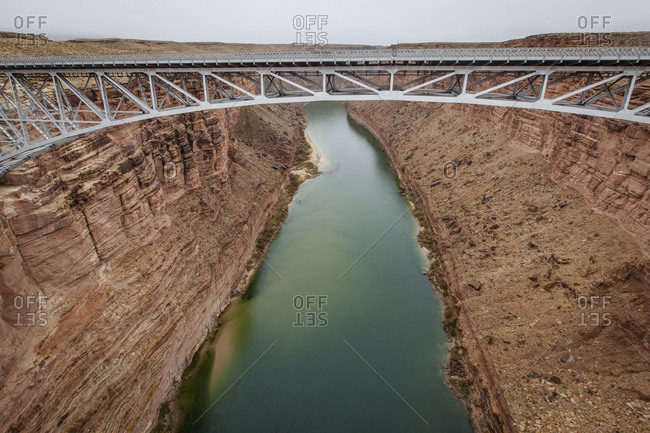 High angle view of bridge over Colorado river amidst rocky mountains at Arizona