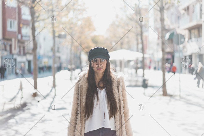 Portrait of stylish young woman in the city
