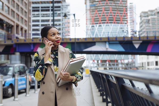 UK- London- portrait of fashionable  businesswoman on the phone