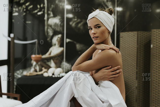 Portrait of nude young woman in a spa
