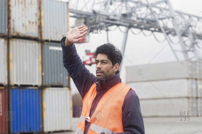 Man wearing reflective vest working at container port