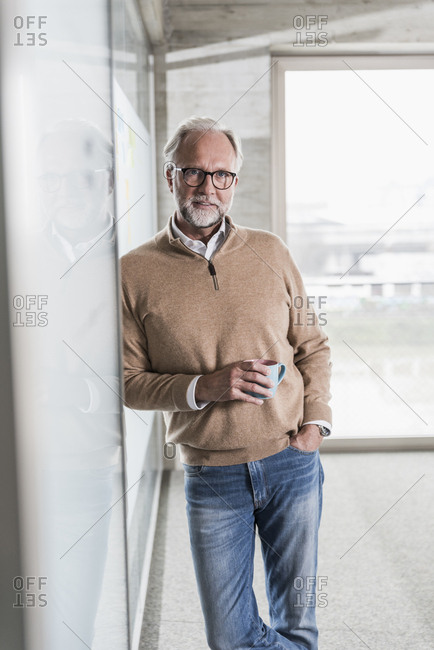 Portrait of casual mature businessman standing in office