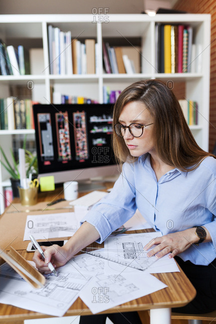 Young woman working in architecture office