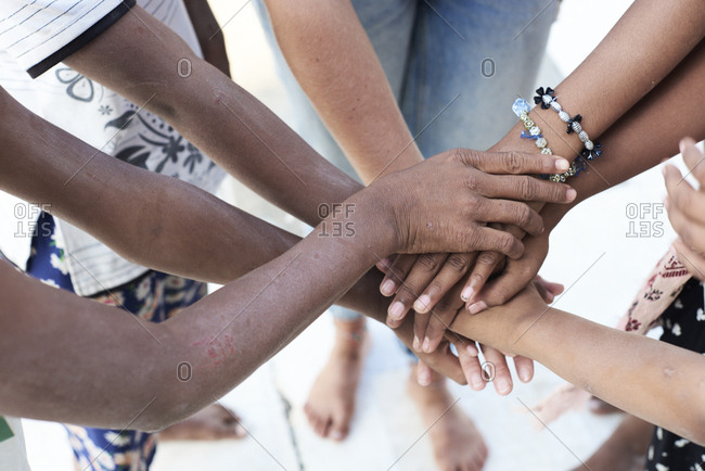 Group of multiethnic people- hands- together