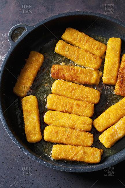 Fish fingers in frying pan