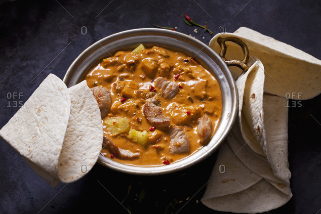 Curry dish with turkey and pineapple in curry sauce
