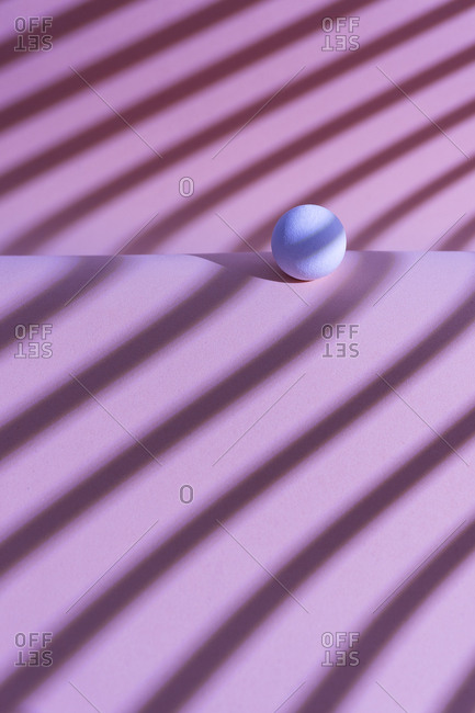 White sphere over a geometric pink background- 3D Rendering