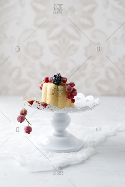Lemon ice cream cake with red currants and blackberries