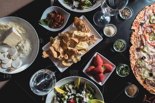 Table with italian food- salads and snacks
