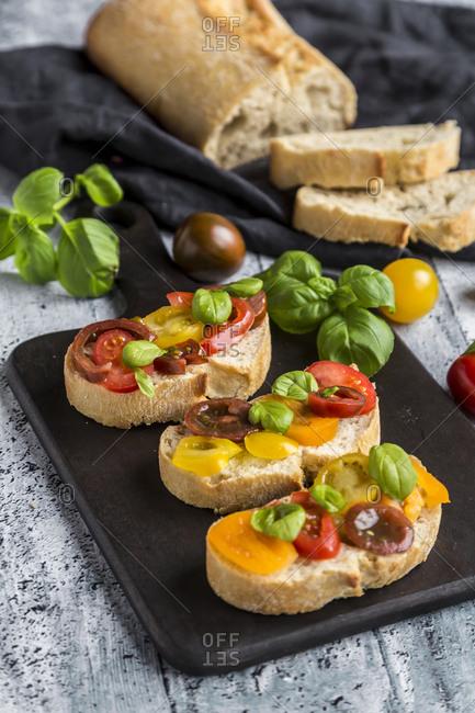 Bruschetta- ciabatta with multi-colored tomatoes and basil