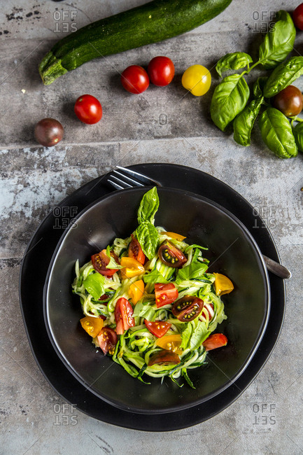 Zoodles- zucchini spaghetti- with tomatoes and basil