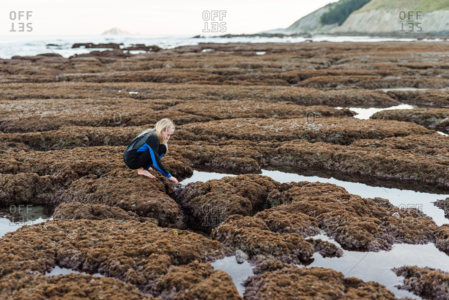 Girl exploring Hawke's Bay, New Zealand and it's tide pools