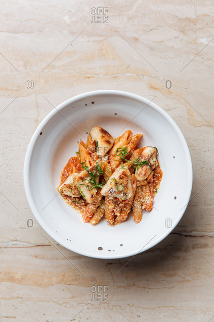 Bowl of chicken pasta with parmesan sprinkles