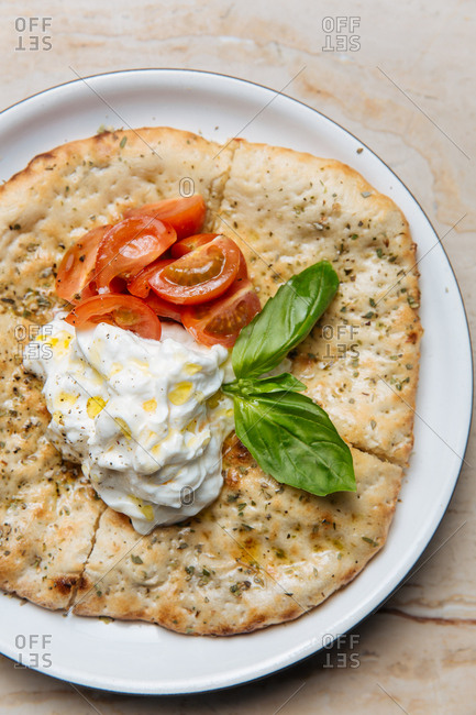 Detail of savory flat bread with cream and oil
