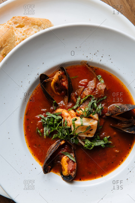 Seafood stew with rich broth and side of toast