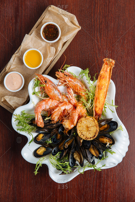 Seafood sampler platter with trio of dipping sauces