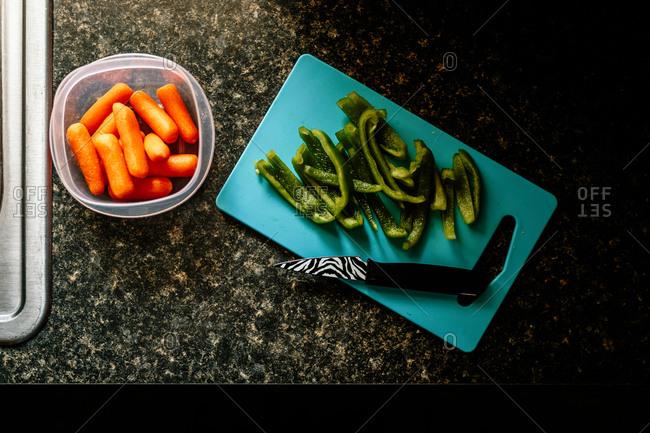 Vegetables being prepared on kitchen counter