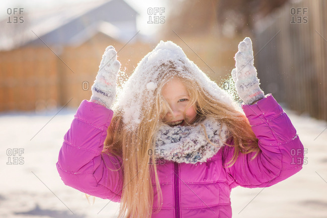 Silly girl throwing snow on hair