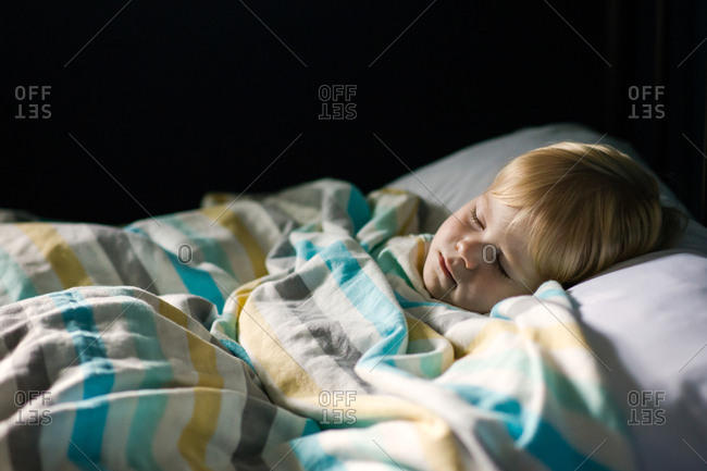 Tired little kid taking a nap