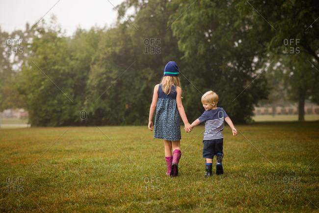 Cute siblings walking together in park