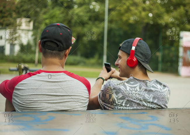 Young men with BMX bikes listening to music in BMX park, Budapest, Hungary