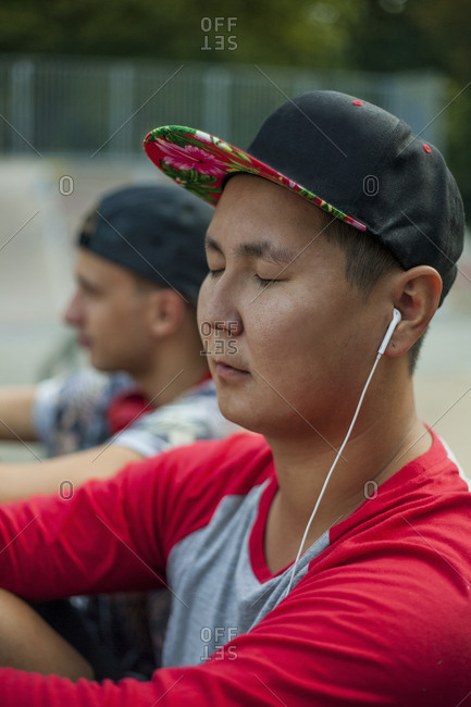 Young men listening to music in BMX park, Budapest, Hungary