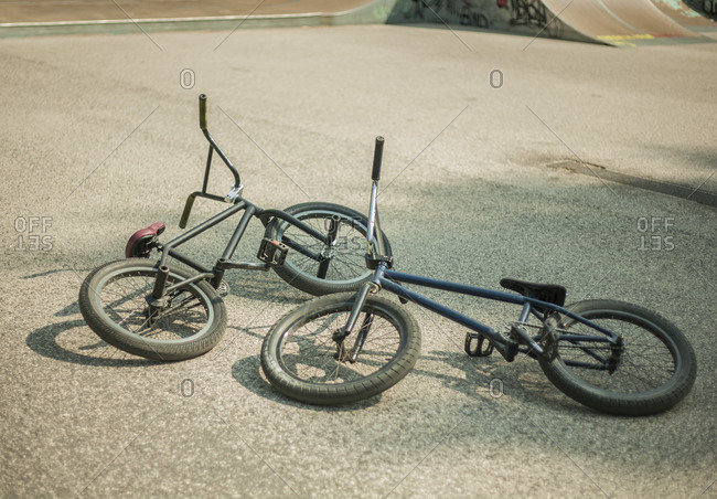 Two BMX bikes lying on their sides in BMX park, Budapest, Hungary
