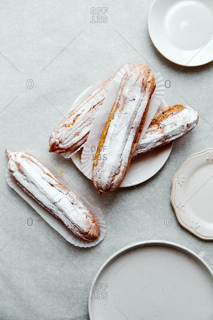 Eclairs with custard and powdered sugar