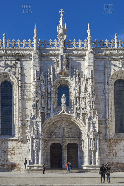 Lisbon, Portugal - 19 February, 2016: Tourists taking photos of the ornate facade of the Jeronimos Monastery and Church of Santa Maria of Belem