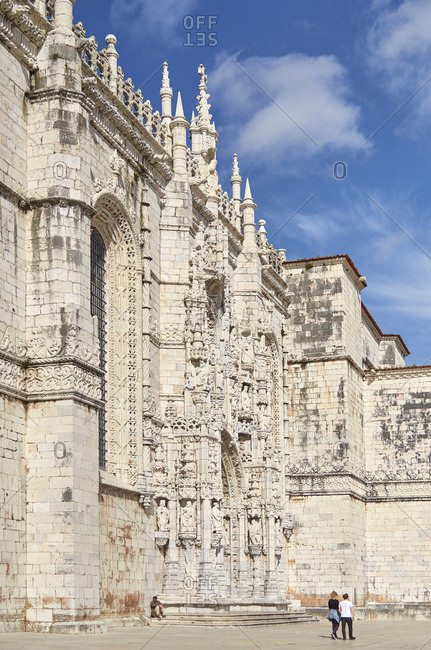 Lisbon, Portugal - 11 March, 2017: Tourists walking by the Jeronimos Monastery and Church of Santa Maria of Belem